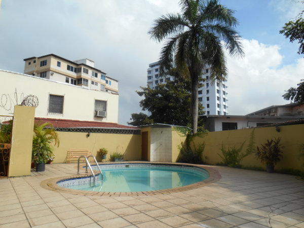 Low rise building selling duplex condo with swimming pools.